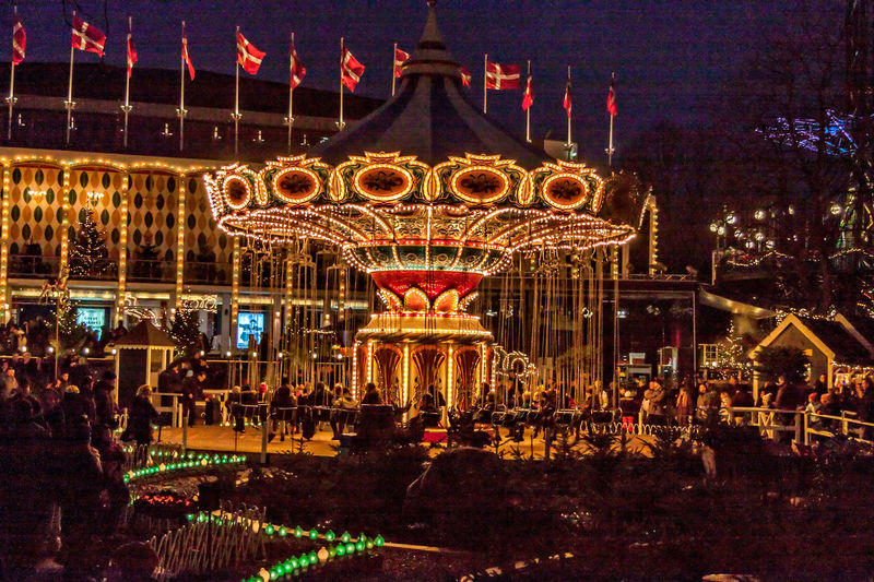Tivoli Denmark Amusement Park Amusement Park Ride Arts Culture And Entertainment Carousel Carrusel Illuminated Night Outdoors