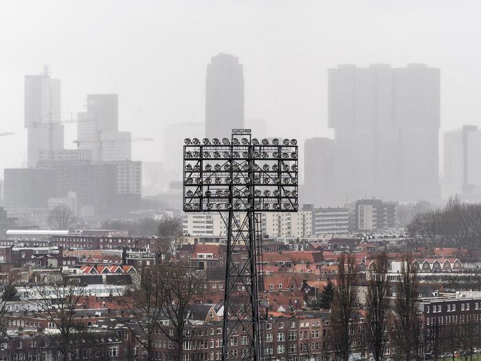 Digital composite image of modern buildings in city against sky