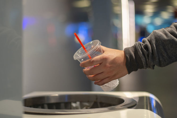Food And Drink Holding One Person Drink Human Hand Hand Real People Refreshment Indoors  Lifestyles Human Body Part Household Equipment Food Freshness Container Close-up Focus On Foreground Men Glass - Material Glass Plastic Bin Recycle Environment Trash