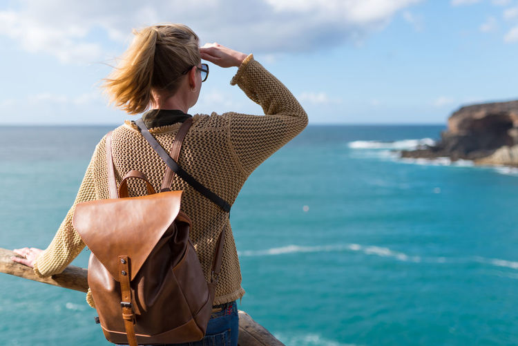 Canary Islands Beach Beauty In Nature Casual Clothing Day Horizon Over Water Leisure Activity Lifestyles Nature Ocean One Person Outdoors Real People Rear View Scenics Sea Shielding Eyes Sky Standing Sunlight Tranquil Scene Water Women Young Adult Young Women