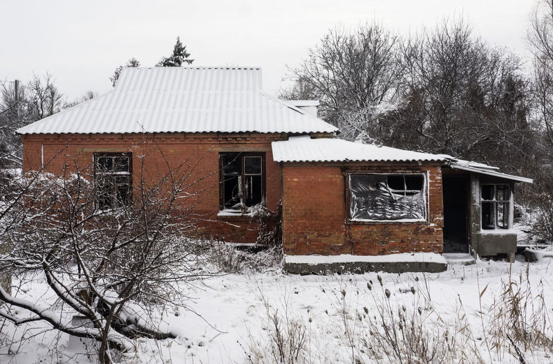 abandoned house covered by snow Home Winter Abandoned Architecture Bare Tree Beauty In Nature Branch Building Exterior Built Structure Cold Cold Temperature Covered Day Destroyed Empty Field Frozen House Landscape Nature No People Outdoors Sky Snow Snowing Tree Weather White White Color Winter