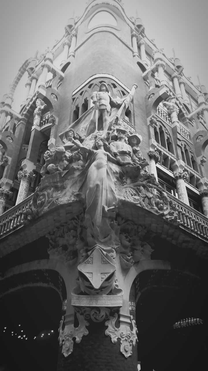 low angle view, statue, sculpture, human representation, spirituality, art and craft, religion, place of worship, architecture, built structure, history, outdoors, no people, day, building exterior, travel destinations, sky