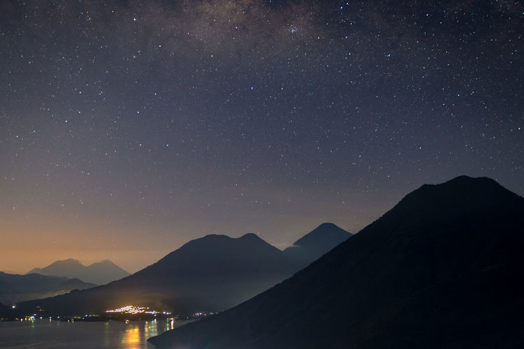 Stars and sunrise at Lake Atitlàn Atitlan Lake Guatemala Astronomy Beauty In Nature Constellation Galaxy Idyllic Infinity Mountain Mountain Range Nature Night No People Outdoors Scenics - Nature Silhouette Sky Space Star Star - Space Star Field Tranquil Scene Tranquility