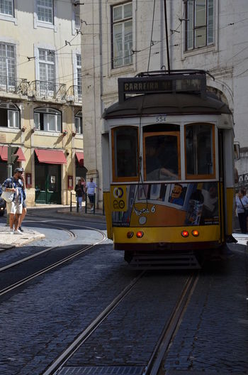 Street City Transportation Building Exterior Adult People Lifestyles Day Outdoors Lisboa Window Fenêtre Sur Le Monde Lisboa🇵🇹 Portugal Oficial Fotos Colection EyeEm© City Portugal_em_fotos Tramway Funicular Funiculaire  Funicular Railway