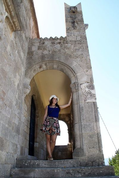 Ancient Arch Architectural Column Architecture Beautiful Woman Building Exterior Built Structure Casual Clothing Doorway Full Length History Low Angle View Old Ruin One Person Outdoors Rhodes Ródos Standing Tourism Tourist Travel Travel Destinations Vacations Young Adult Young Women