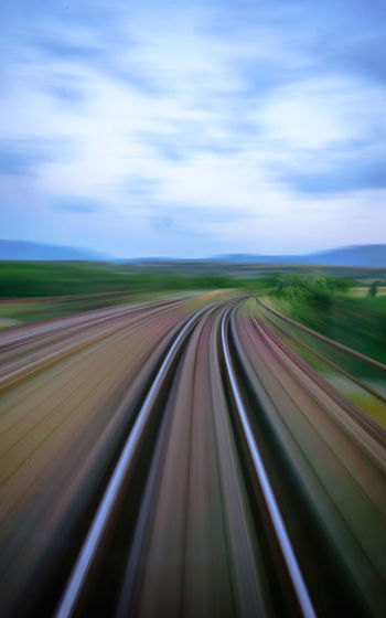 Abstract Cloud - Sky Day Grass High Speed Landscape Motion Movement Nature No People Outdoors Road Scenics Sky Speed Train Transportation Zooming Your Ticket To Europe The Week On EyeEm AI Now