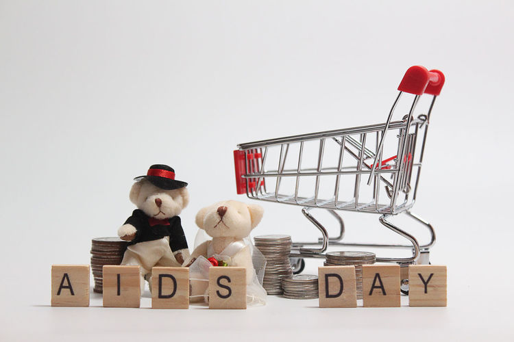 Shopping Cart And Toys With Text On White Background