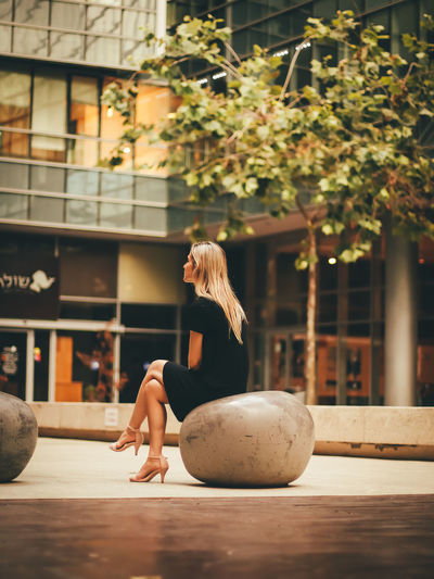 Woman Sitting On Seat In Shopping Mall