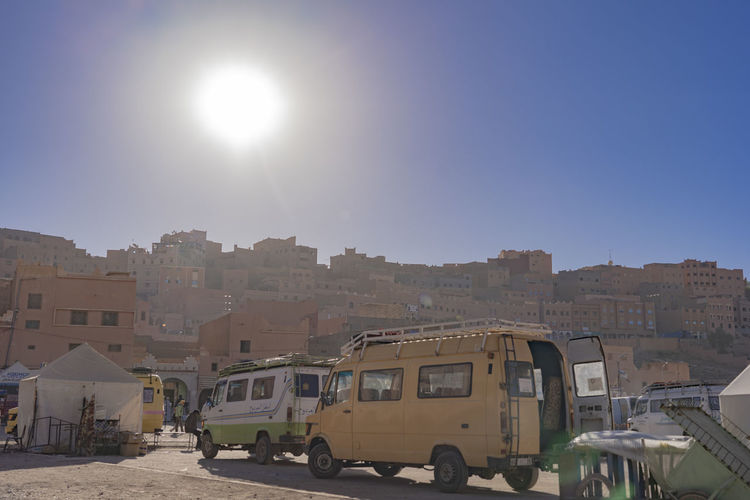 Mode Of Transportation Transportation Sky Architecture Land Vehicle Sunlight Building Exterior City Motor Vehicle Day Clear Sky Outdoors Red Brick Wall Red Brick Building Arabic Arabian Arabic Style Desert City Arabic City Middle East North Africa Morocco Midday Sunny Car