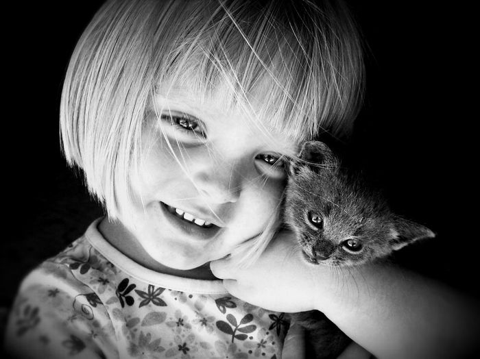 Animal Themes Black & White Black And White Blackandwhite Blackandwhite Photography Childhood Close-up Cute Elementary Age Front View Girls Girl Head And Shoulders Headshot Indoors  Innocence Kitten Leisure Activity Lifestyles One Animal Person Portrait Showcase April My Favorite Photo The Portraitist - 2016 EyeEm Awards Fresh On Market May 2016 Fresh On Market 2016