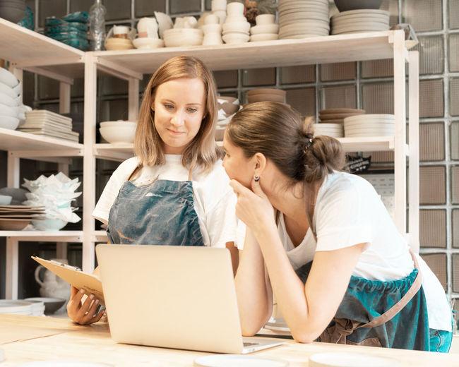 Smiling women wearing working at workshop