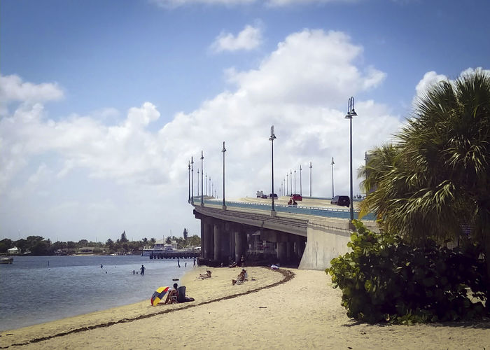 Architecture Beach Bridge Bridge - Man Made Structure Built Structure Cloud - Sky Day Men Mode Of Transport Nature Nautical Vessel Outdoors People Real People Sand Sea Sky Sun Transportation Tree Water