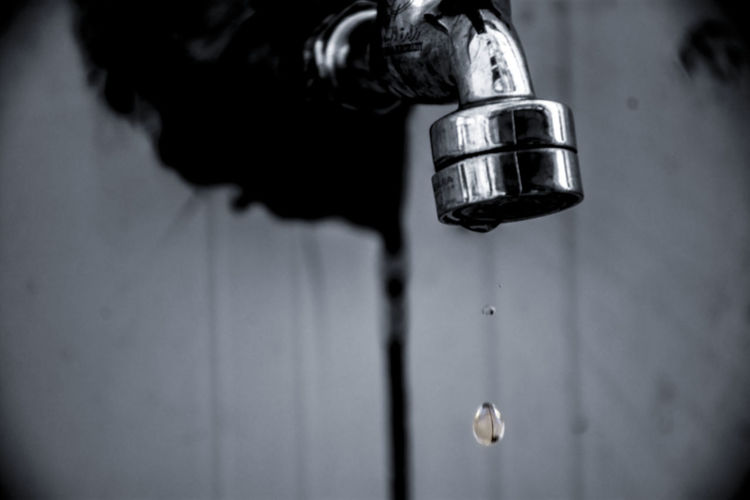 Close-up of water falling from faucet