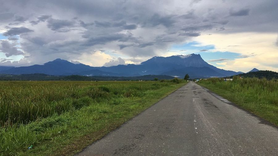 Mt. Kinabalu. Mt. Kinabalu Cloud - Sky Sky Road The Way Forward Direction Transportation Mountain Diminishing Perspective Environment Landscape Beauty In Nature Scenics - Nature Nature Mountain Range Tranquil Scene Tranquility vanishing point