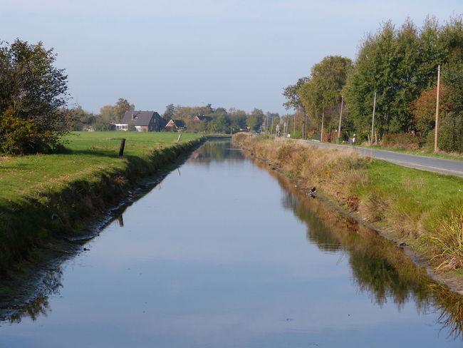 Channel in Moordorf Ostfriesland North Sea - Kanal Aurich Nordsee Südbrookmerland Moormuseum Moor work Arbeit skipper Schiffer Boot Bootfahren ship water Wasser Wasserweg waterway sunny sonnig Landschaft Landleben landscape landlife Luft air breath atmen health Gesundheit Ursprung ursprünglich origin life Leben east frisian Bauernhof Wolken sky Himmel clouds Reflection Water Sky Grass Scenics - Nature Landscape Outdoors Tranquil Scene No People Day Nature Kanal Ostfriesland Ostfriesland Kultur Ostfriesland Landschaft Ostfriesische Landschaft Ostfriesisch Friesland Channel