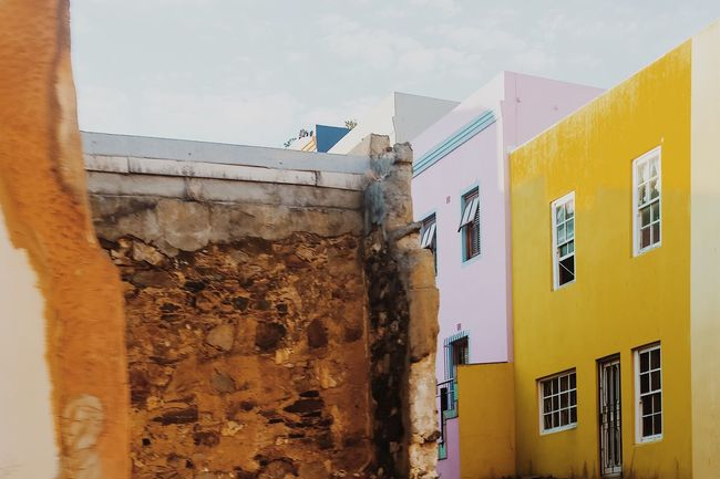 Architecture Built Structure Building Exterior Sky Low Angle View No People Outdoors Day Homes City Street Full Frame Colorful Street Photography South Africa The Way Forward City Photography Themes Architecture Bo-kaap Wall - Building Feature Wall Real People