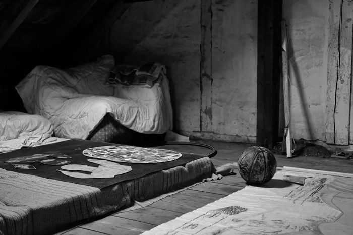 Early models of the universe Basketball Abandoned Adult Art And Craft Attic Ball Bed Bedroom Day Domestic Room Full Length Furniture Home Interior Indoors  Occupation Old Relaxation Table Women Wood - Material