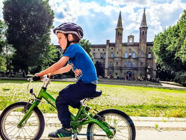 Church Tower Kid On A Bike Bike Architecture_collection Fahrradfahren Kid Photography People Photography People Watching Child Photography Child On Bicycle Adventure Club