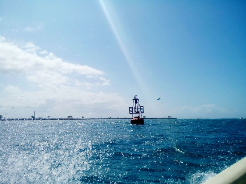 Water splash, buoy, huge kites, parasailing; LIFE! @ Turtle Island Waters, Bali, Indonesia. Taken Aug 12th, 2015. Bali Turtle Island Offshore Water Splash Open Water On Boat Blue Sky White Clouds Blue Sea Buoy INDONESIA
