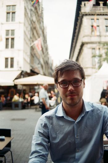 Café time Adult Analogue Photography Antwerp Architecture Beer Building Cafe City City Life Eyeglasses  Film Film Photography Front View Looking At Camera Man One Person Outdoors Pentax People Person Portrait SLR SLR Camera Smile Young Adult
