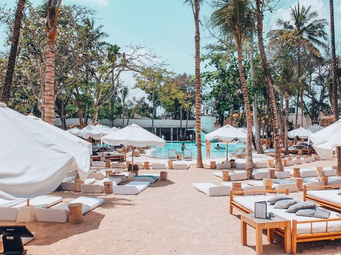 Relax Vacations EyeEmNewHere Bali Sun Oasis Lounge Chill Daybed Travel Destinations Sunlight Tourist Resort Lounge Chair Sand Outdoors Parasol