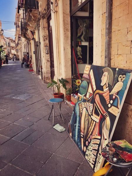 Ortigia Giudecca - Ortigia Chair Architecture Built Structure Day Building Exterior No People Outdoors Sicilia Sicily ❤️❤️❤️ Siciliabedda The Architect - 2017 EyeEm Awards Architecture_collection Discover Your City Walking Around Enjoying The View Architectural Feature Architectural Detail Architecturelovers Paint Painting Paintings City Architecture Great Atmosphere