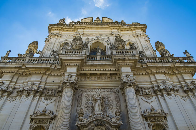 Basilica of st john the baptist at lecce against blue sky