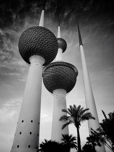 Low angle view of kuwait towers against sky in city