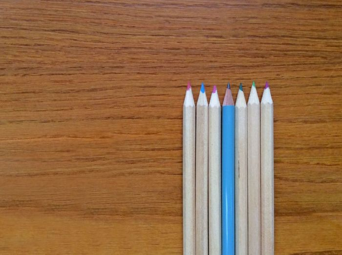 Cropped Colored Pencils On Wooden Table