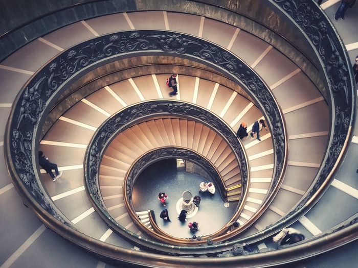 High angle view of people on spiral staircase