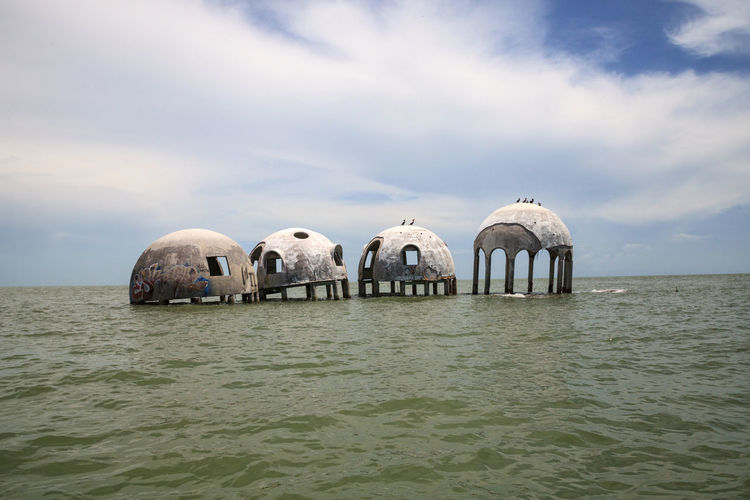 Blue sky over the Cape Romano dome house ruins in the Gulf Coast of Florida Cape Romano Dome House Coastline Ocean View Ruins Wreck Abandoned Blue Sky Cape Romano Day Dome Dome Home Dome Homes Erosion Florida Gulf Of Mexico Landscape Nature No People Ocean Outdoors Sky Water Wreckage