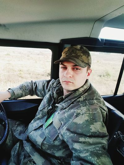 Portrait Of Army Soldier Sitting In Car