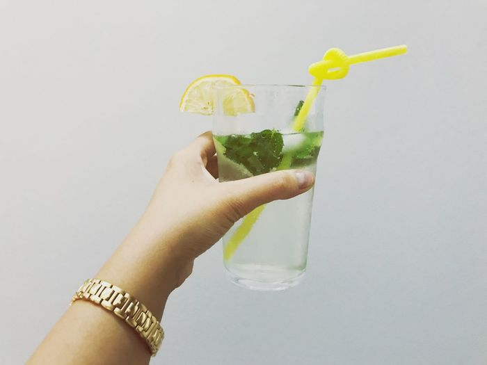 Drink Human Hand Refreshment Cocktail Food And Drink Holding Human Body Part Drinking Straw Real People White Background Freshness Drinking Glass Alcohol Studio Shot One Person Mint Leaf - Culinary Close-up Mojito Day Tropical Drink Be. Ready. Colour Your Horizn