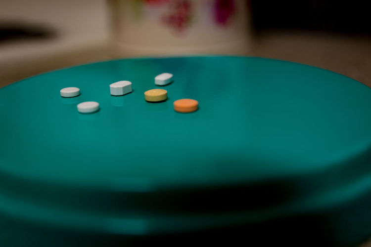 High Angle View Of Pills On Green Stool