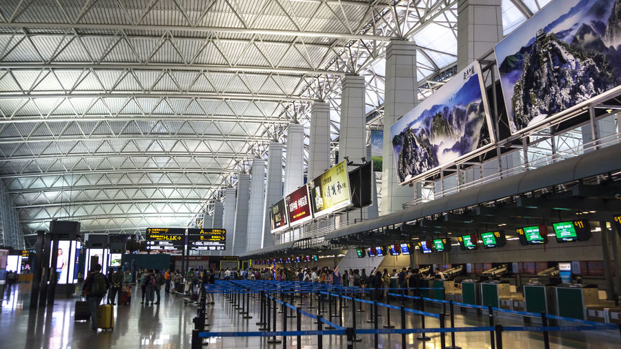 Guangzhou Airport HUAWEI Photo Award: After Dark Airport Airport Terminal Architecture Built Structure Crowd Early Morning Group Of People Illuminated Indoors  Journey Large Group Of People Lighting Equipment Modern Transportation Travel