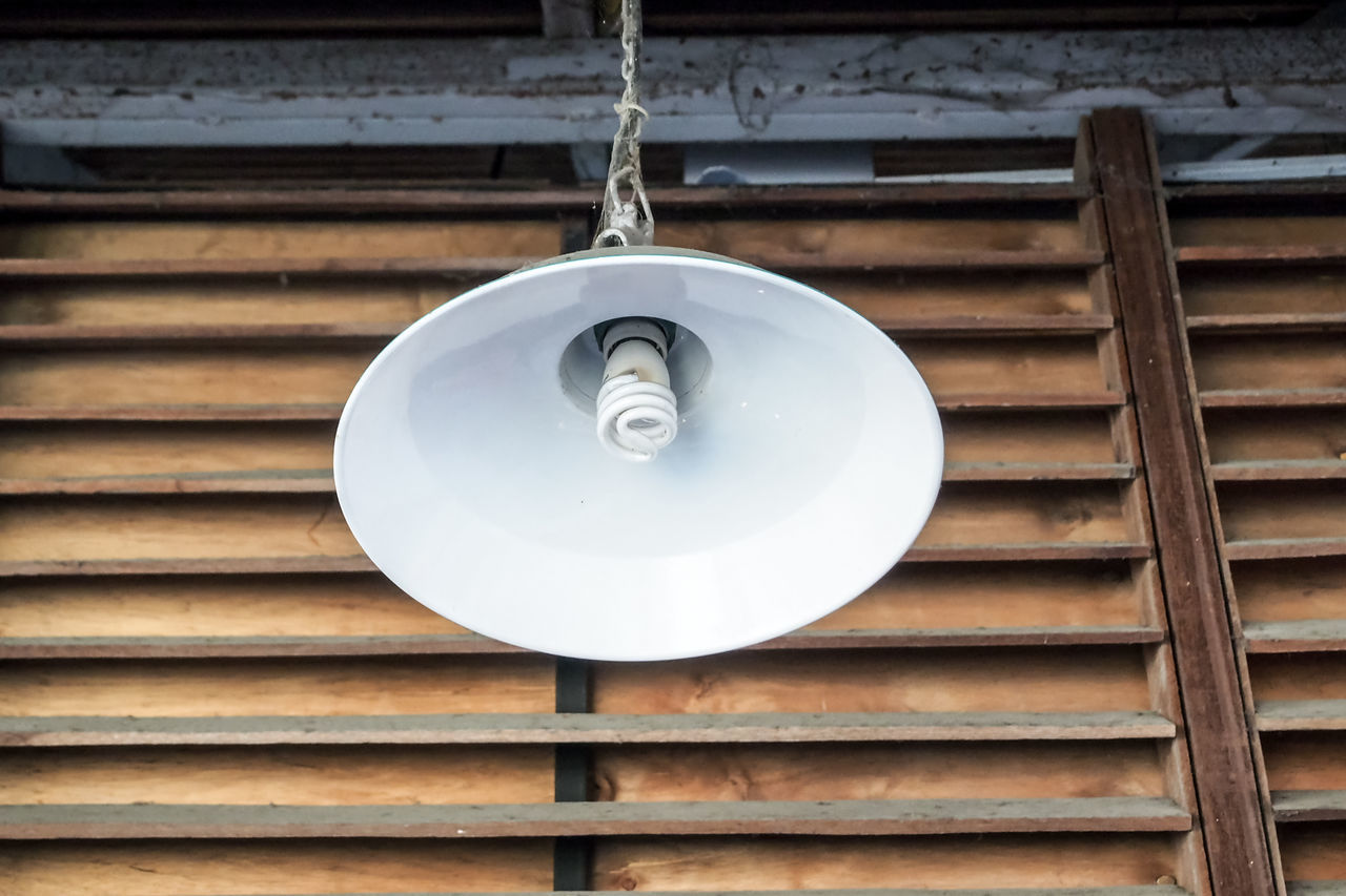 Low Angle View Of Pendant Light By Window Shutter