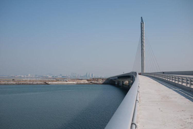 A new connection in the making Modern Sky Bridge Crossing Korea Perspective Incheon Newbuild Songdo Bridge - Man Made Structure Engineering Connection Transportation Architecture Water Built Structure Suspension Bridge Day No People Outdoors Road City