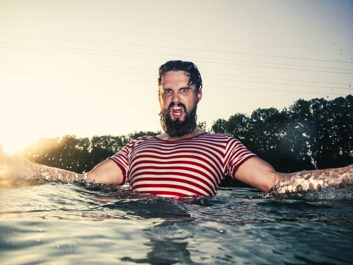 Angry Man Masculinity Spartan Warrior Beard Facial Hair Front View Lake Lifestyles Looking At Camera Male Muscles Muscular Build Nature Offensive One Person Outdoors Portrait River Striped Strong Water Young Adult Young Men