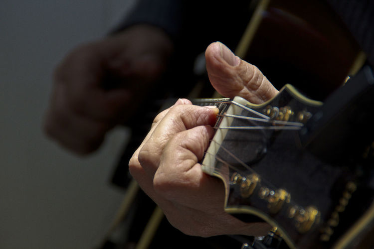 Focus On Foreground Guitar Holding Human Finger Indoors  Music Musician Person