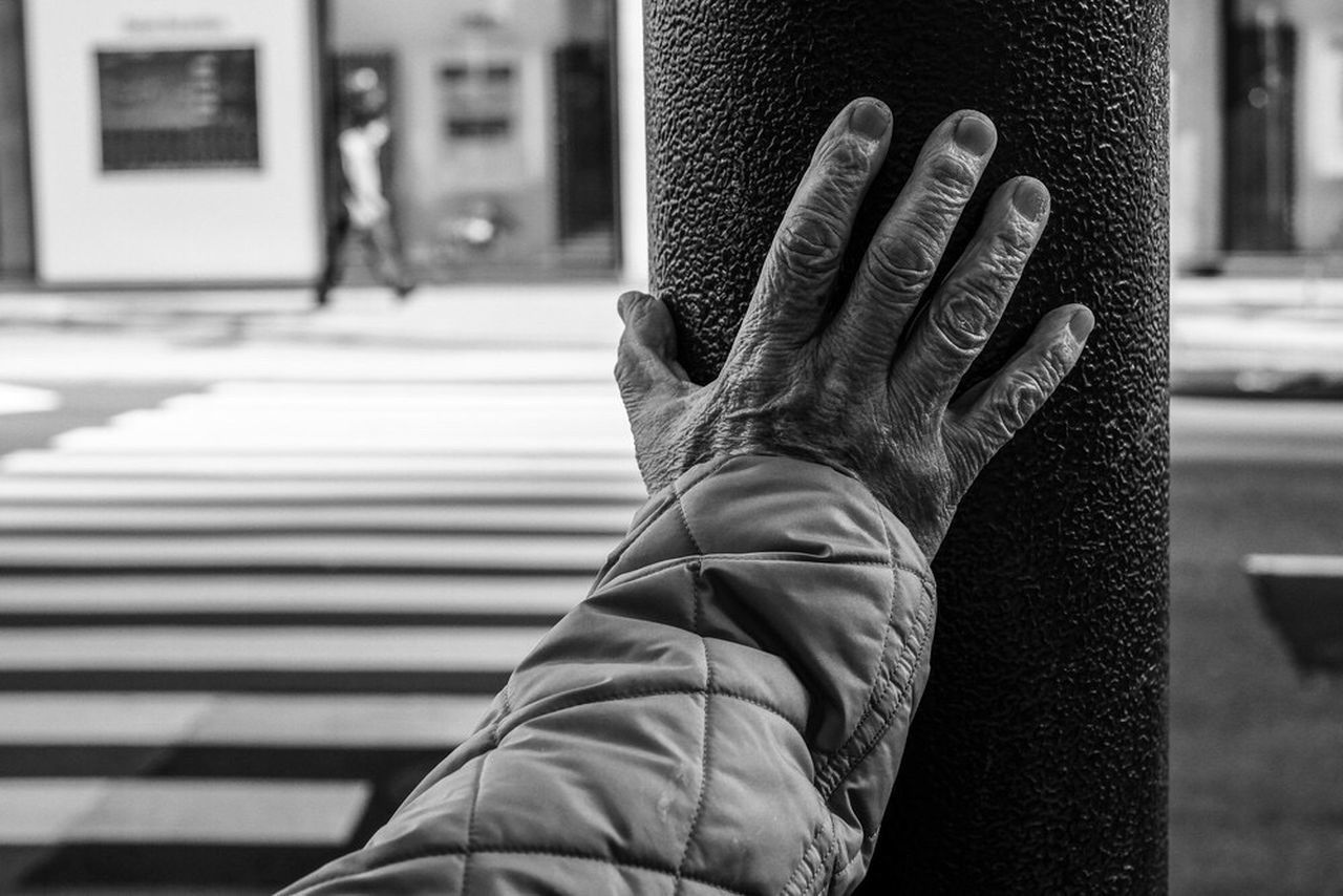 human body part, body part, real people, architecture, one person, focus on foreground, built structure, day, city, men, unrecognizable person, low section, human leg, personal perspective, lifestyles, transportation, building exterior, leisure activity, sign, outdoors, human limb, finger, human foot