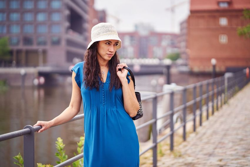 Hamburg Romantic Warm Colors Brown Hair Handrail  Blue Dress Hut Pretty Girl Summer Venezuela Skeptical Bag Town Canal Water Urban Lifestyle Alone person White Had Brown Hair Human Hand Sundress