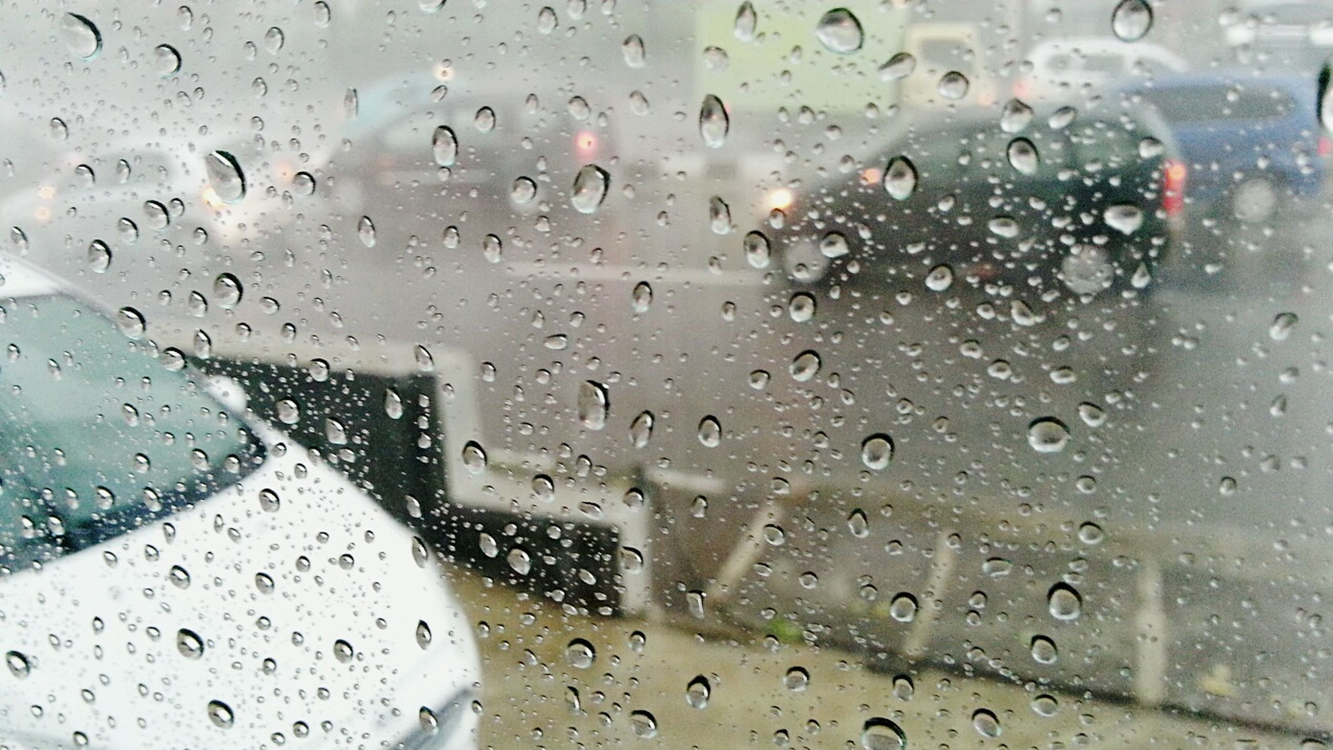 drop, wet, window, indoors, rain, glass - material, transparent, water, season, weather, raindrop, full frame, glass, backgrounds, vehicle interior, monsoon, transportation, car, close-up, focus on foreground