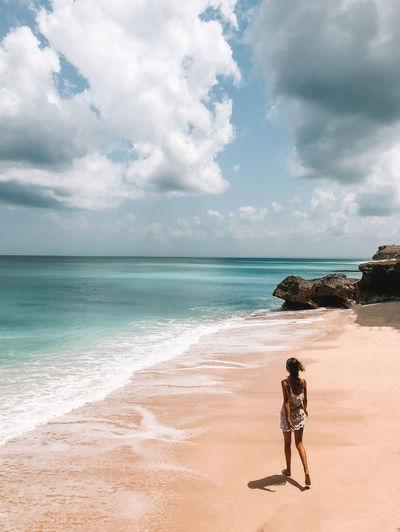 Woman running on the beach in Uluwatu, Bali Sea Beach Water Sky Cloud - Sky Beauty In Nature Scenics - Nature Real People Horizon One Person Full Length Leisure Activity Sand Nature Outdoors Girl Woman Walking Summer Bali Bali, Indonesia Uluwatu Paradise Paradise Beach Tropical