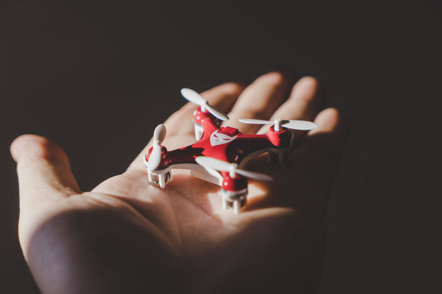 Holding a mini drone in my hand Black Background Close-up Drone  Flight Fly Flying Holding Human Hand Start Up Startup Sunlight Tech Technology