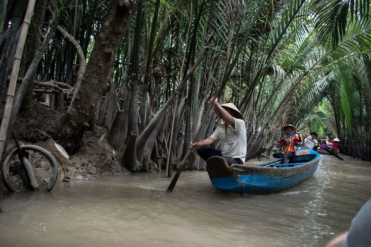 Mekong Delta Mekong River Adult Day Full Length Leisure Activity Lifestyles Men Nature Nautical Vessel Outdoors People Real People Sitting Togetherness Transportation Tree Vacations Water
