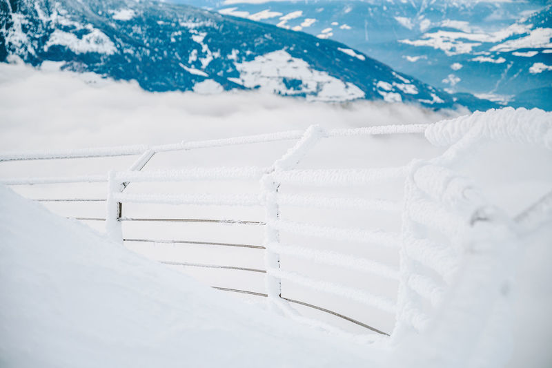 Fence on snow covered mountain