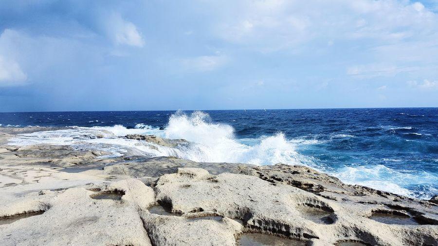 Windy at Malta in November! Travel Destinations Travel Photography Blue Sea Waves, Ocean, Nature Waves Mediterranean Sea Malta Sliema Water Wave Sea Beach Sand Power In Nature Summer Sky Horizon Over Water Close-up Pebble Beach Seascape Rushing Rocky Coastline Ocean