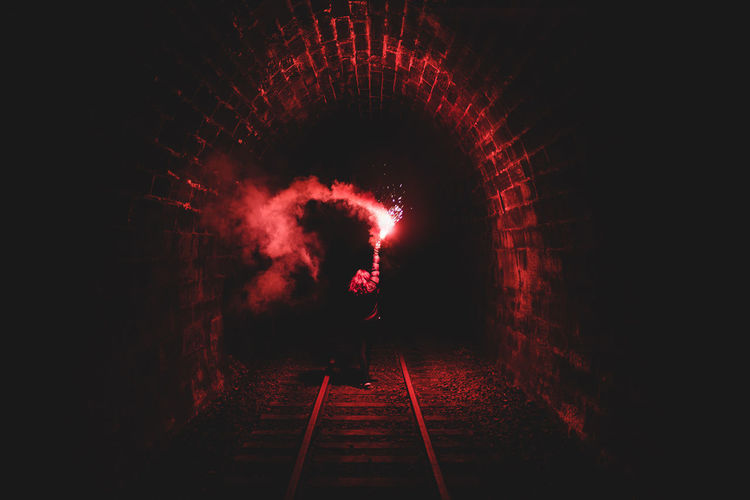 Dark Darkness Flare Glowing Illuminated Lifestyles Motion Nature Night Red Scary The Way Forward Tunnel Underground Unknown Unrecognizable Person Urbex