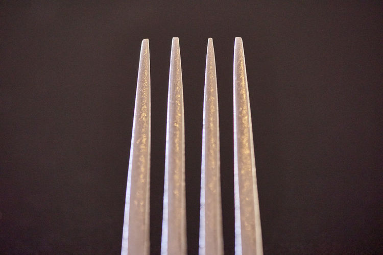 Close-Up Of Fork Against Wall