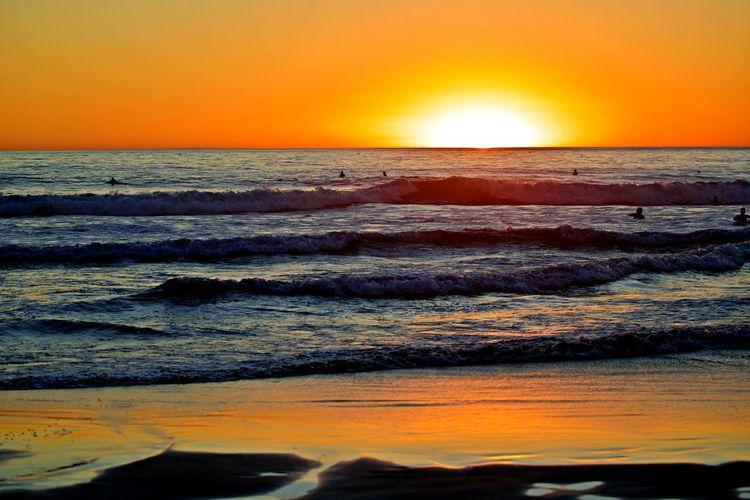 Sea Sunset Sky Water Orange Color Horizon Over Water Beauty In Nature Scenics - Nature Horizon Motion Wave Beach Sun Idyllic Nature Outdoors Power In Nature Moody Nature